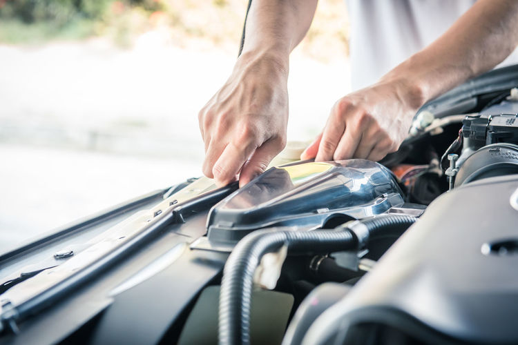 Auto mechanic checking car engine,worker selective focus