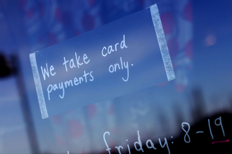 We Take Card Payments Sign On Glass Window