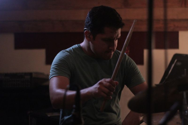The drummer EyeEm Selects Music Musical Instrument One Person Arts Culture And Entertainment Musician String Instrument Artist Young Men Musical Equipment Indoors  Skill  Real People Performance Playing Men Sitting