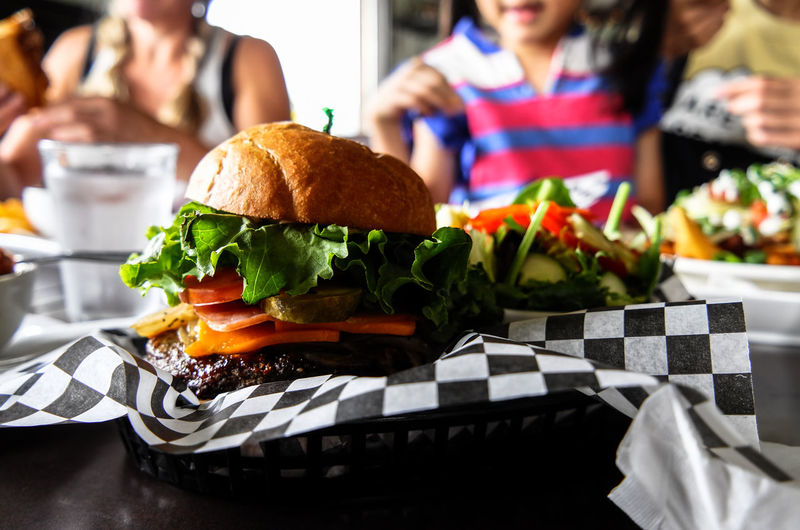Hamburger Still Life Burger Food Food And Drink Sandwich Table Indoors  Ready-to-eat Group Of People Fast Food Freshness Women Healthy Eating Vegetable Focus On Foreground Hamburger Plate Snack Vernon Canada Lunch Time! Restaurant Real Life