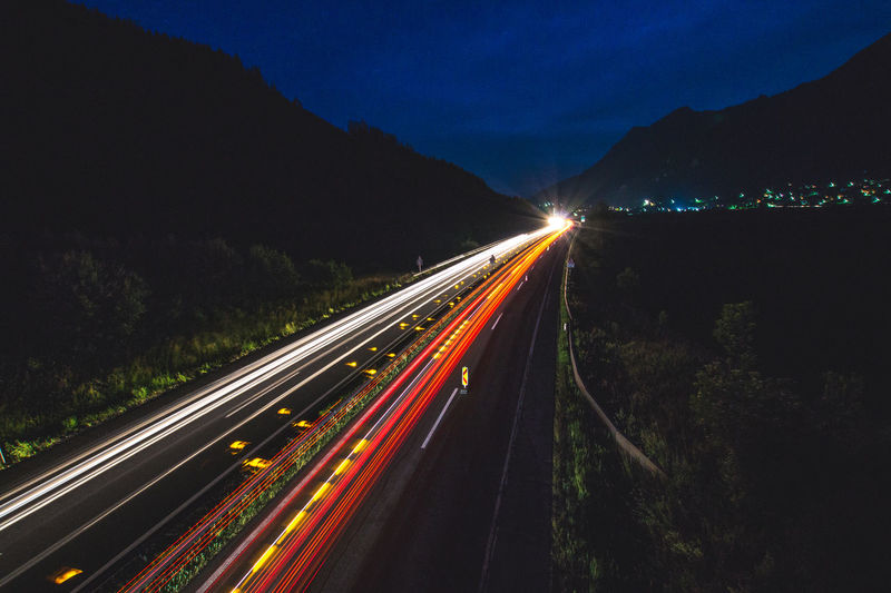 Cars Night Lights The Week On EyeEm Beauty In Nature Blurred Motion Driving Home High Angle View High Street Highway Illuminated Light Trail Long Exposure Motion Mountain Nature Night Nightlife No People Outdoors Road Sky Speed Transportation Tree