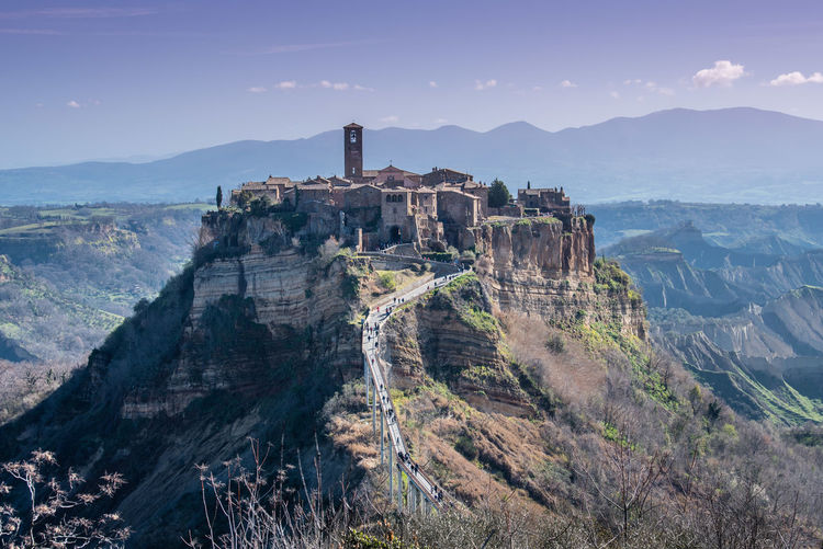Panoramic view of castle on mountain against sky