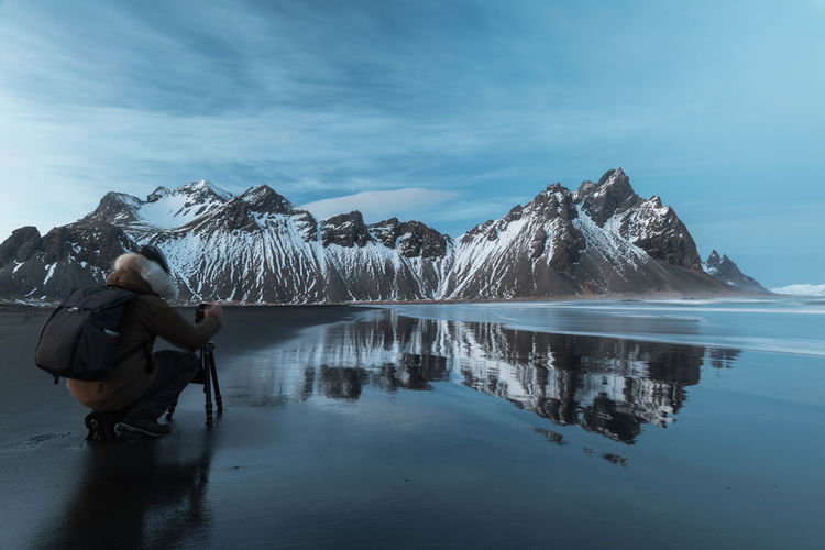 Adventure Beauty In Nature Black Sand Beach Iceland Cold Temperature Day Lake Lifestyles Mountain Mountain Range Nature One Person Outdoors Reflection Scenics Sky Snow Tranquility Water Winter