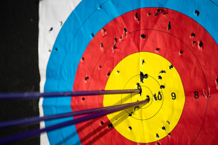 Accuracy Sport Close-up Red Target Shooting No People Sports Target Blue Leisure Activity Day Number Circle Midsection Equipment Outdoors Yellow Shape Competition Archery Nautical Vessel