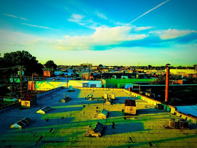 The sun rest away from the city. Sunset Sky Clouds And Sky Clouds City Richmond Richmond, VA Virginia Rooftop Rooftop View  Rooftop Scenery Boxes White Blue Sky Blue Green Color Green Yellow Brown Stadium Cartoonish Sun Sunlight