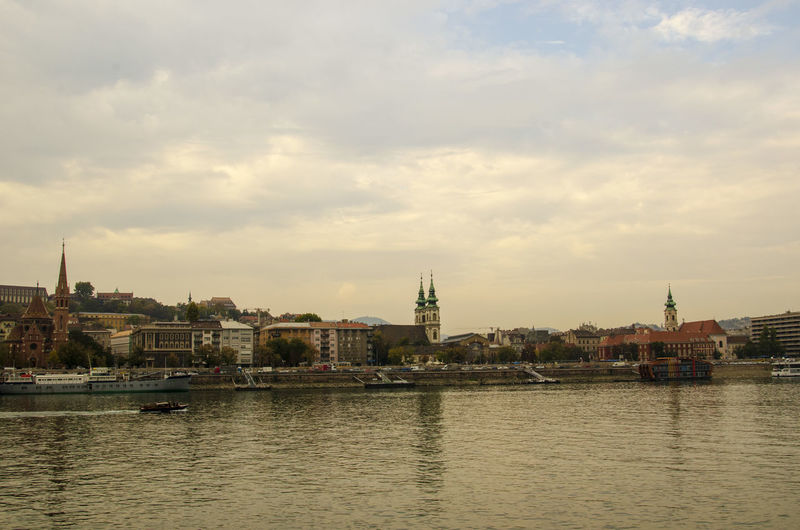 Amazing Landscapes of Budapest, Views of Hungary Sky Building Exterior Architecture Built Structure Water Cloud - Sky Waterfront City Building River Nature Nautical Vessel Religion Place Of Worship No People Transportation Outdoors Spirituality Belief Cityscape Passenger Craft Spire  Budapest Budapest, Hungary Budapest Streetphotography Budapest - Hungary Hungary Hungary I <3 You Hungary🇭🇺 Hungary Photos