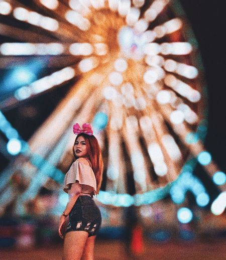Low angle view of woman in amusement park