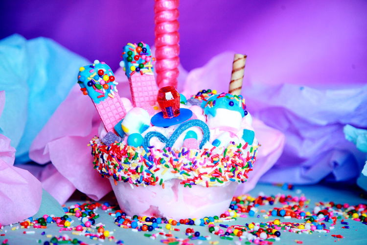Close-up of birthday cupcake by crumpled paper