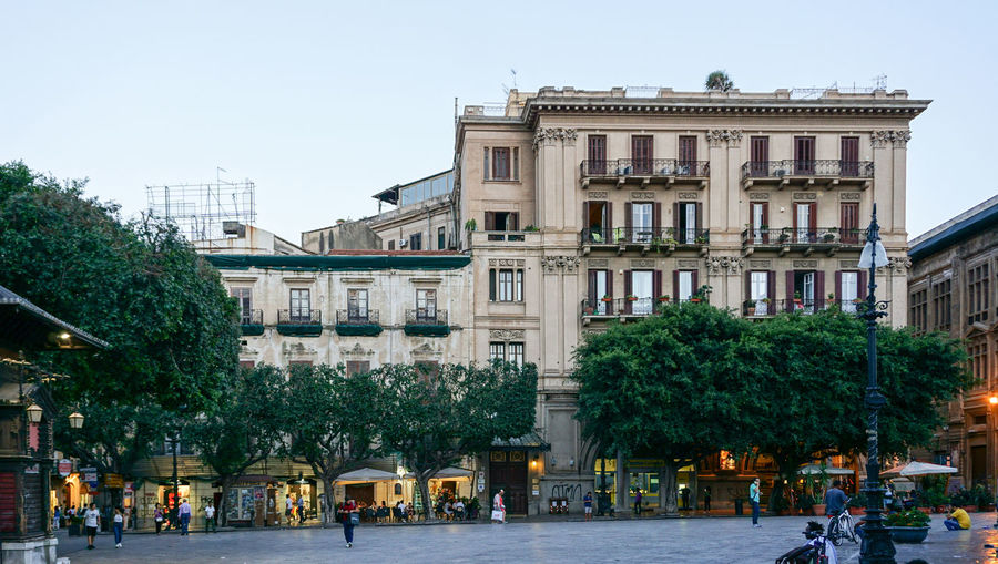evening in Palermo, Italy Architecture Built Structure Incidental People Street Window Residential District Travel Destinations City Life Palermo Place Evening Tree Plant City Sky Sicily