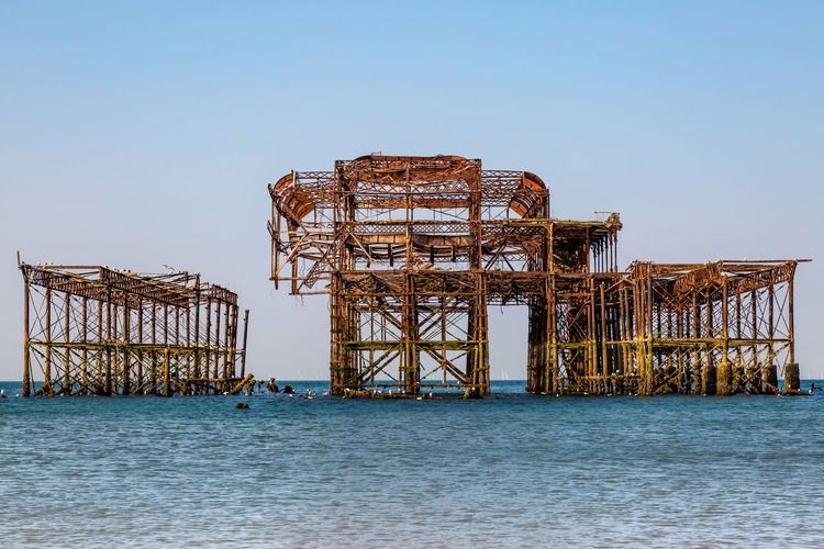 The ruins of Brighton's West Pier on a sunny summer's morning Ruins Abandoned Architecture Blue Built Structure Clear Sky Coastal Landscape Copy Space Day Horizon Horizon Over Water Hove Iconic Industry Nature No People Outdoors Sea Sky Sussex Travel Travel Destinations Water Waterfront West Pier