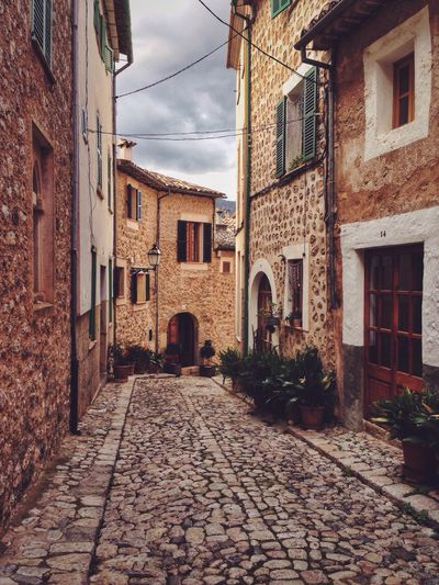 Street and houses in Biniaraix, Mallorca, Spain Mallorca Travel Photography Travel Travel Destinations Biniaraix SPAIN No People Cobblestone House Building Village Street Historic Buildings The Architect - 2016 EyeEm Awards