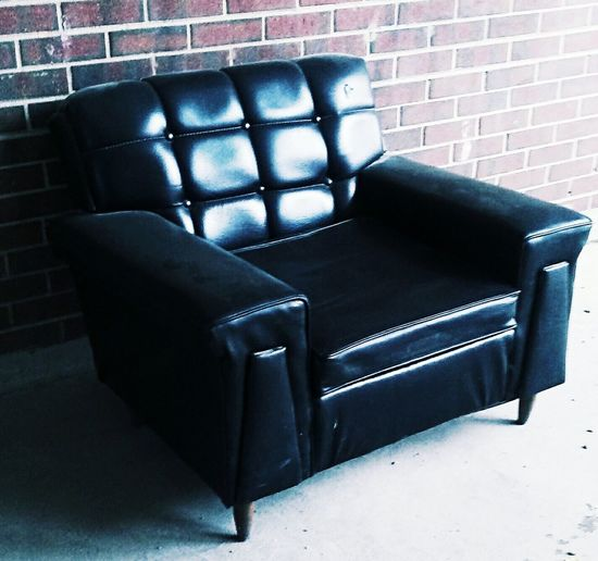 Chair Check This Out Black Random Brick Background Still Modern Photography Art Boulder Colorado Posh Outdoors Waiting Patiently