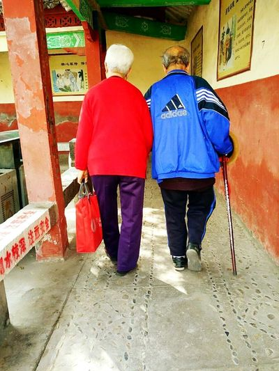 Full Length Two People Rear View Built Structure Senior Adult Architecture Senior Women Adult Adults Only People Men Day Building Exterior Red Women Togetherness Outdoors Real People Only Women