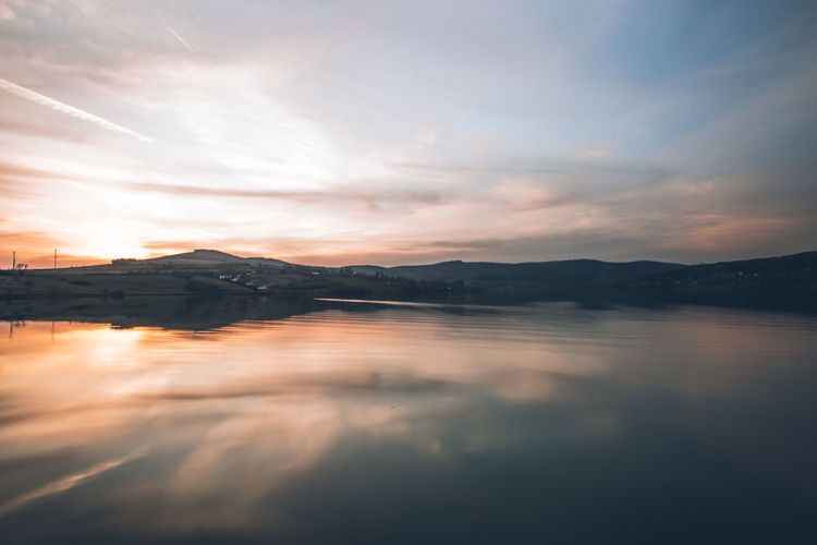 Beauty In Nature Cloud - Sky Idyllic Mountain Mountain Range Nature No People Non-urban Scene Outdoors Reflection Scenics - Nature Sea Sky Sunset Tranquil Scene Tranquility Water Waterfront