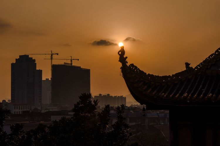 Silhouette Roof Of Tianxin Pavilion Against Sky During Sunset