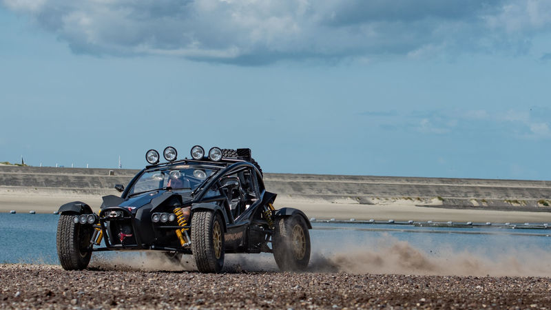 An Ariel Nomad buggy kicks off some gravel on the coast. Adventure Ariel Nomad Buggy Cross Driving Go Journey Moving Netherlands NOMAD Off Road On The Move Zeeland  Second Acts Be. Ready.