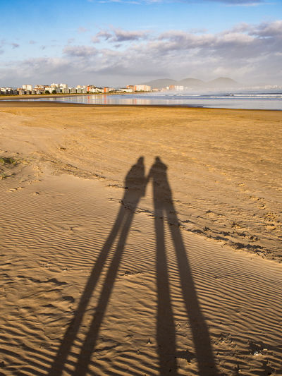 Shadow of people on beach