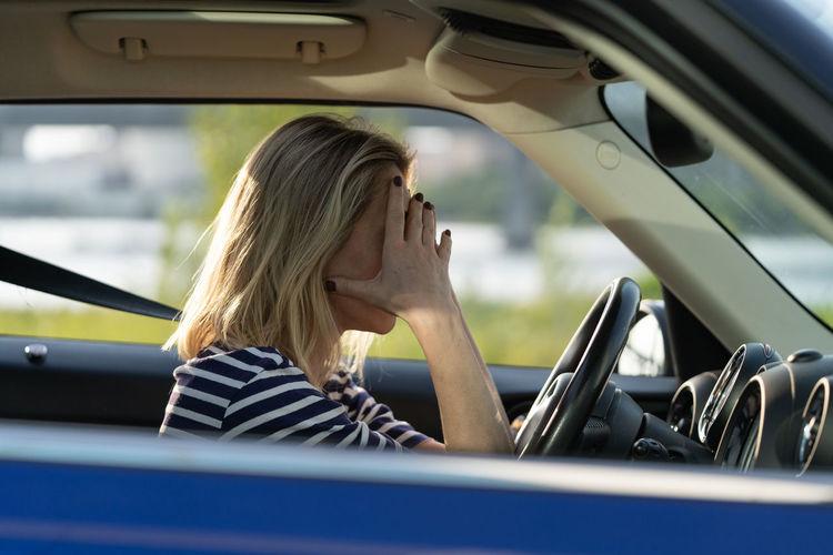 Portrait of woman sitting in car