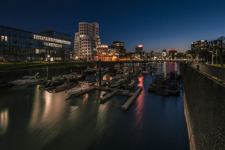 Düsseldorf Architecture Building Building Exterior Built Structure City Clear Sky Illuminated Mode Of Transportation Moored Nature Nautical Vessel Night No People Outdoors Reflection River Sky Transportation Water Waterfront