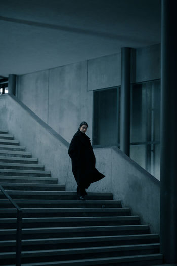 Woman moving on staircase
