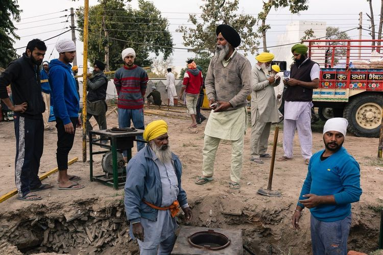Volunteers preparing the cooking pits for a festival. Anandpur Sahib, India. Real People Teamwork Streetphotography Travel Photography Punjab India