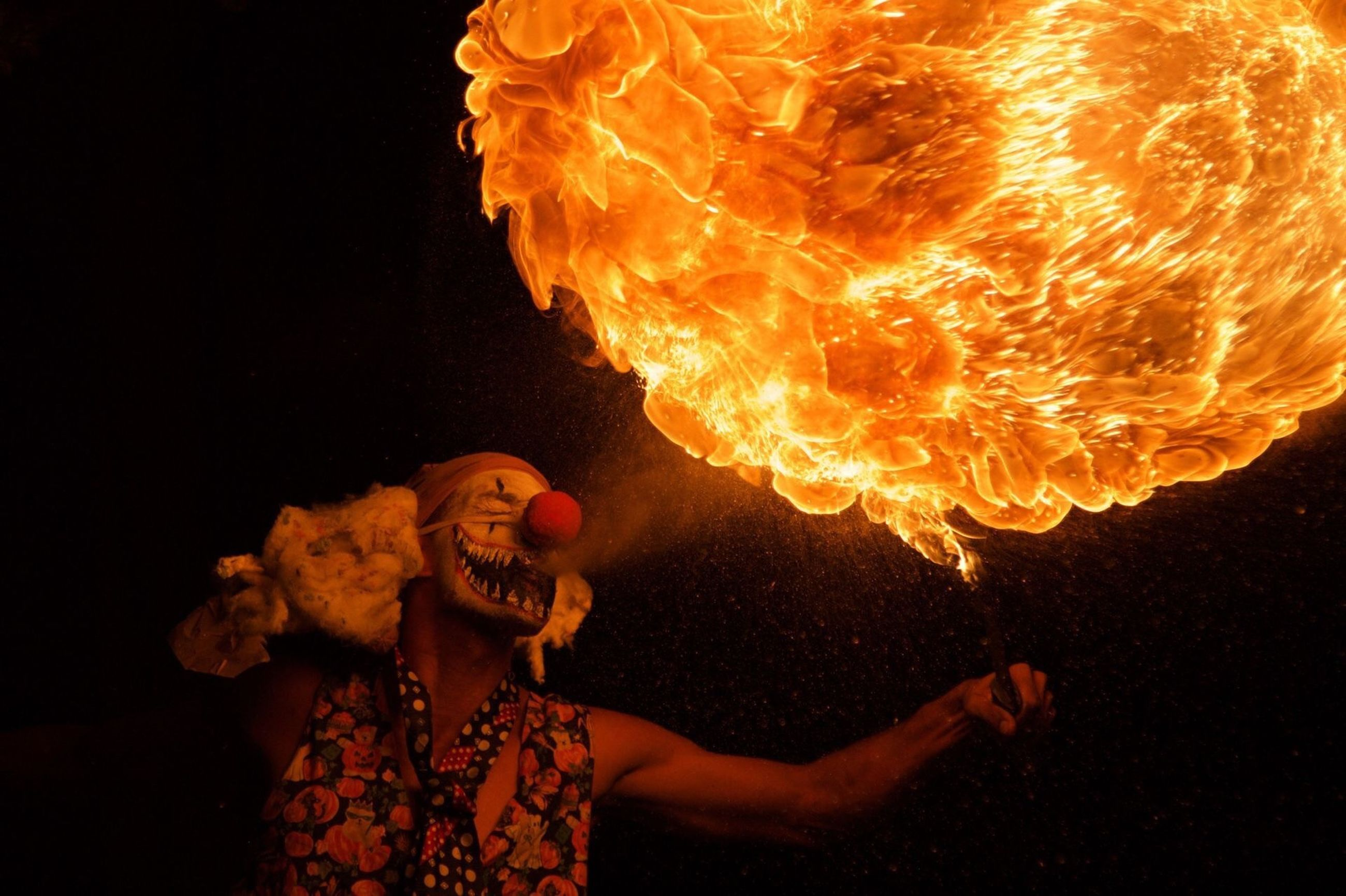 flame, danger, burning, heat - temperature, human mouth, risk, night, orange color, skill, performance, one person, performing arts event, young adult, red, fireball, young women, indoors, adults only, people, adult