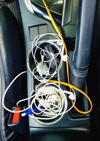 cluttered. Earphone Cable Earphones Gear Powerbank Sitbelt Pen Incar Storage Compartment Storage Close-up
