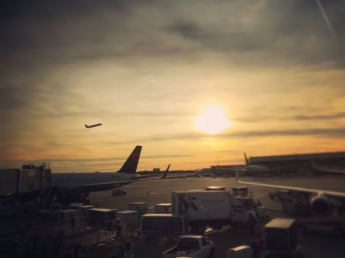 Flying Sunset Mid-air Sky Dusk City Airplane Building Exterior Cloud - Sky Bird Cityscape Sun Built Structure Architecture Air Vehicle Airport Photography Day Travel Traveling Take Off Airport Airport Terminal Luggage Trolleys Let's Go. Together. Investing In Quality Of Life