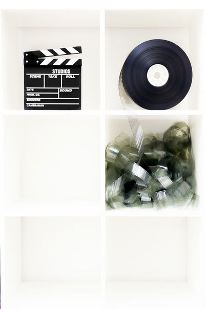 Movie objects on white shelf Clapper Clapper Board Close-up Day Film Filmstrips Indoors  MOVIE No People Reel Shelf White White Background