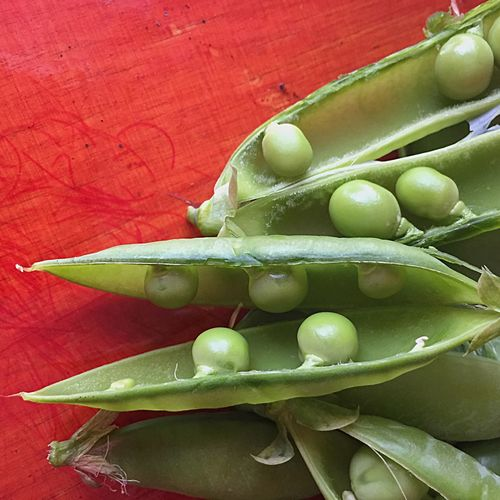High angle view of peas in pod on table