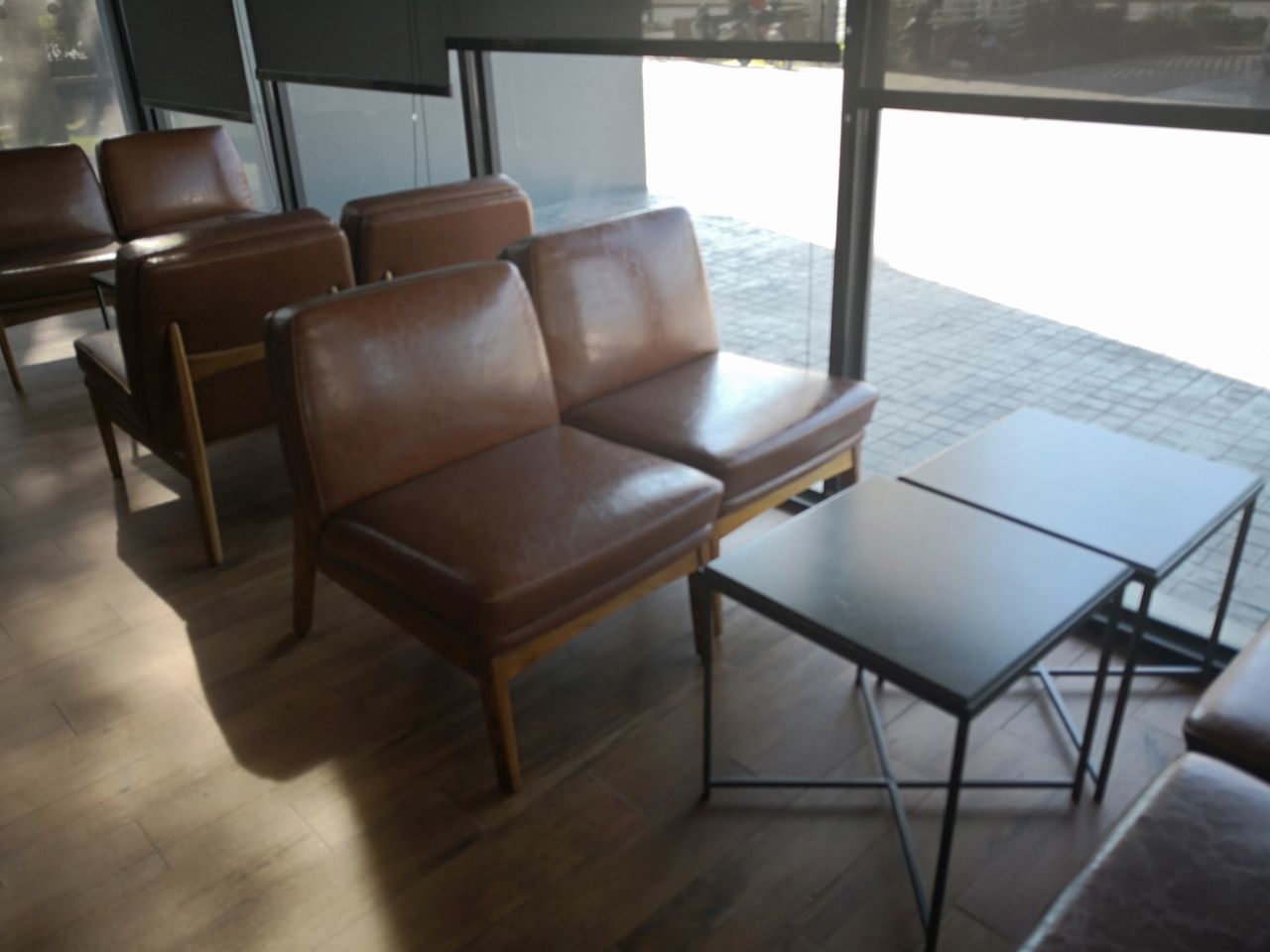 EMPTY CHAIRS AND TABLES ON HARDWOOD FLOOR
