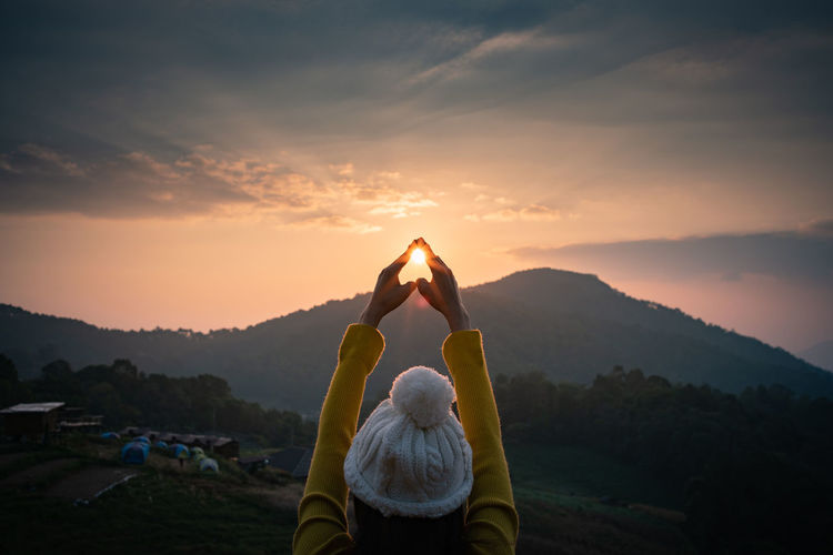 Sunset Sky Mountain Rear View Lifestyles Beauty In Nature Scenics - Nature Leisure Activity Real People Human Arm Arms Raised Orange Color Cloud - Sky Tranquil Scene Nature Tranquility Exercising Healthy Lifestyle Yoga Relaxation Exercise Sun Mountain Range Hand Outdoors