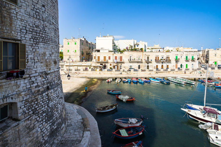 Giovinazzo harbor, Apulia, Italy Apúlia Puglia Architecture Building Building Exterior Built Structure Canal City Cityscape Clear Sky Day Giovinazzo Gondola - Traditional Boat Italy Mode Of Transportation Nature Nautical Vessel No People Outdoors Residential District Sky Southern Italy Transportation Travel Travel Destinations Water