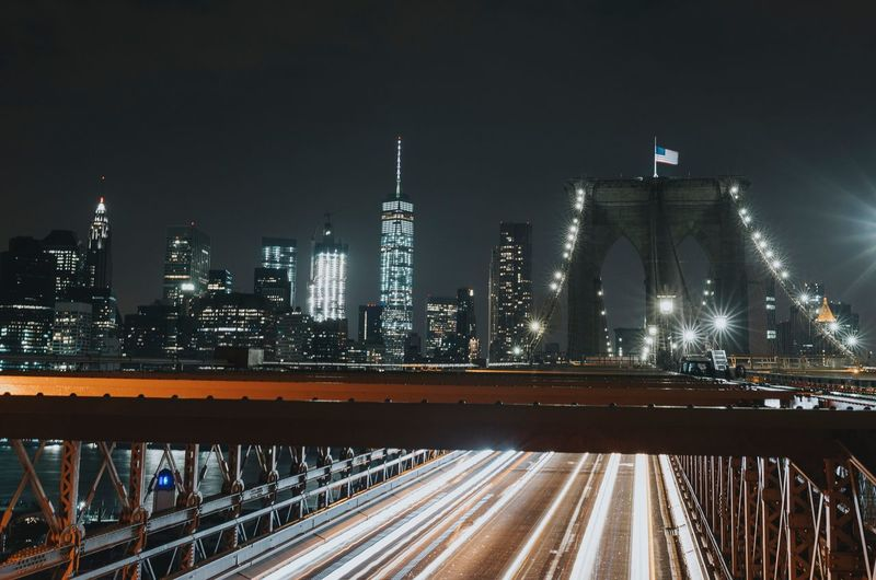 High angle view of light trails on illuminated brooklyn bridge at night