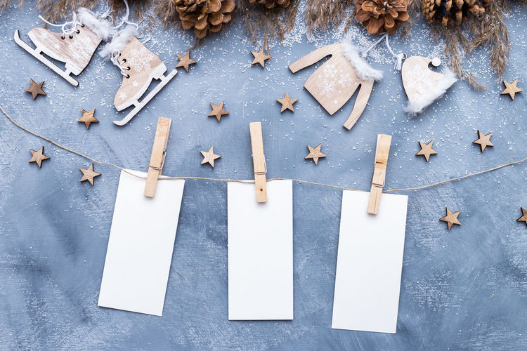 Directly above shot of blank adhesive notes with christmas decorations on table
