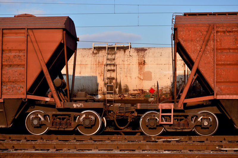Trains at railroad tracks against sky