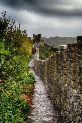"""Óbidos is a Portuguese town in the district of Leiria, in the Centre Portuguese region and close to the Atlantic Ocean coast. The name Óbidos comes from the Latin """"oppidum"""", which means """"fortified city"""". Definitely a """"must see destination"""" on your next trip to this surprising country. Find more here http://bit.ly/1NjgnA5 Ancient Civilization Architecture Beautiful Built Structure Cities City Discovering Europe History Leiria Medieval Narrow Old Photography Places Portugal Stone Stone Wall Town Travel Traveling Visiting Wall Óbidos  Finding New Frontiers"""