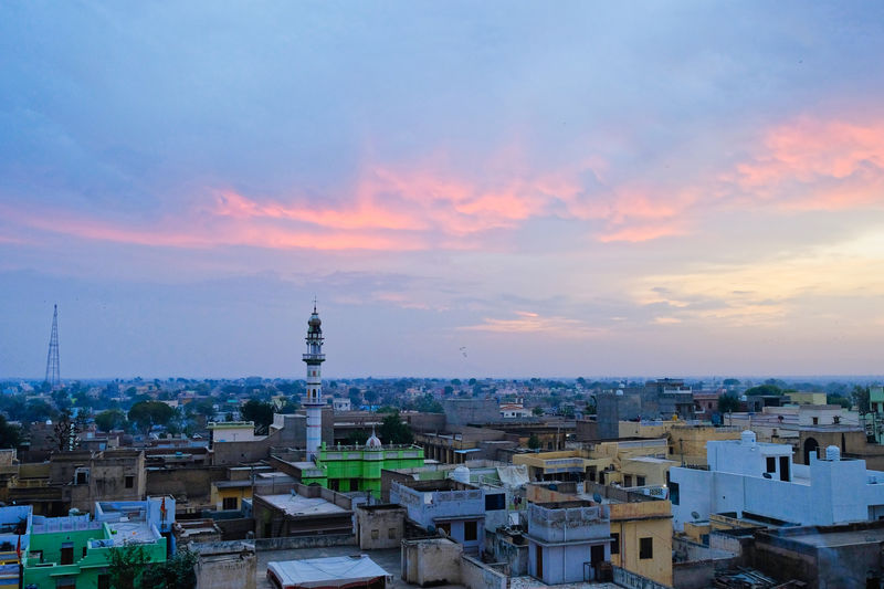 Sunset over old town old Mandawa, India. ASIA India Mandawa, Rajasthan Old Town Architecture Building Building Exterior Built Structure City Cityscape Cloud - Sky Crowded High Angle View Mandawa Nature Old City Outdoors Place Of Worship Residential District Romantic Sky Sky Spire  Sunset Tower TOWNSCAPE Travel Destinations