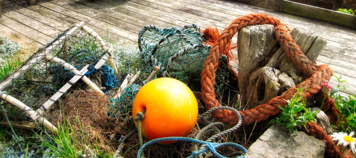Fishing Tangle Grass Rope Fishing Gear Floats Lobster Pots Nets No People Wooden Decking Yellow