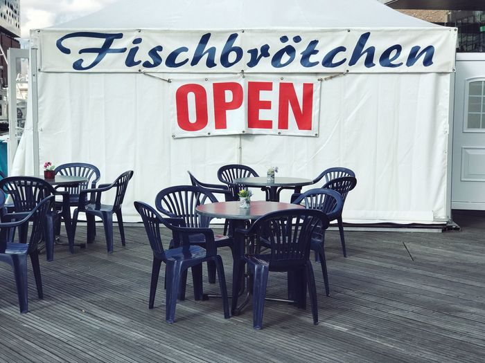 Fish and Chips Shop in Hamburg Text Western Script Chair Table Communication Capital Letter Empty Restaurant Cafe Day No People Outdoors