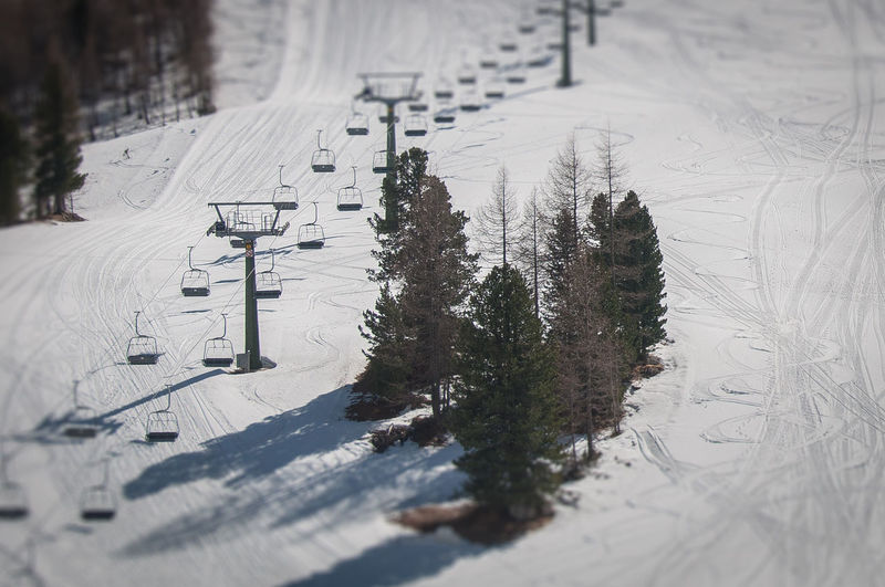 Tilt shift ski traces and lift in rope, Passo Falzarego, Dolomites, Italy Dolomites Passo Falzarego Veneto Abstract Activity Alpine Alps Clouds Cortina D'Ampezzo Descend Entertainment Europe European  Fun Healthy Holiday Italy Lens Effect Lifestyle Lift Marks Mountain No People Rope Ski Ski Rope Sky Slope Snow Sport Springtime Tilt Shift Tourist Traces Trees Vacations Outdoors Field Land Nature Tree Winter