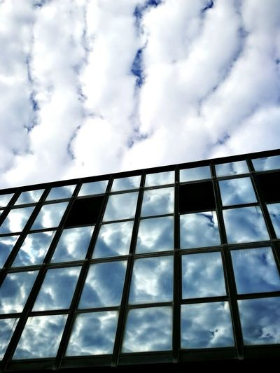 Low Angle View Sky Cloud Window Reflection Cloud - Sky Glass - Material Building Exterior Cloudy Blue Geometric Shape Office Building No People Full Frame Cumulus Cloud Fluffy Cloudy Reflections And Shadows