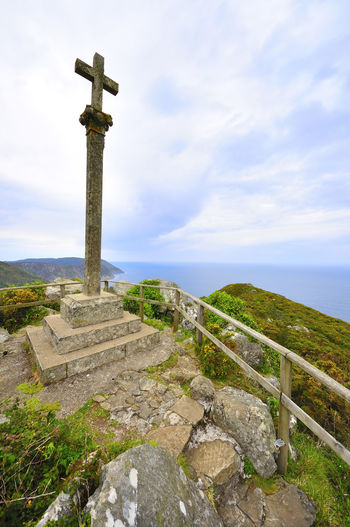 coast of death in galicia spain SPAIN Coast Of Death Galicia Spain Ancient Beauty In Nature Cloud - Sky Coast Of Death In Galicia Spain Cross Day History Horizon Over Water Nature No People Outdoors Religion Scenics Sea Sky Spirituality Tranquil Scene Tranquility Travel Destinations