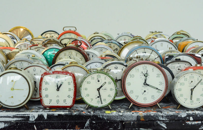 Close-up of clocks on table