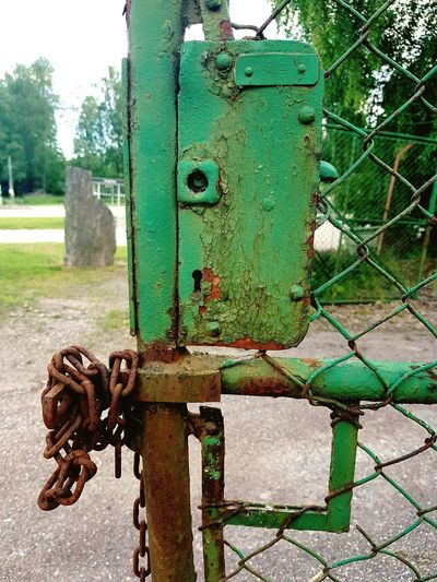 Rust we trust In Rust, We Trust Chainlink Fence Chainlink Old Lock Lock Green Green Color Rusty Rusty Metal Rusty Things Rusty Chain Rusty Chain Protection Metal Safety Security Lock Close-up Sky Deterioration Peeling Off Weathered Peeled Worn Out