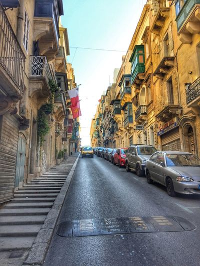 Streetview in Valetta, Malta Architecture Building Exterior Built Structure Car City Day Historical Building Land Vehicle Mode Of Transport Narrow Street No People Outdoors Road Sky Street Streetphotography Streetview The Way Forward Transportation