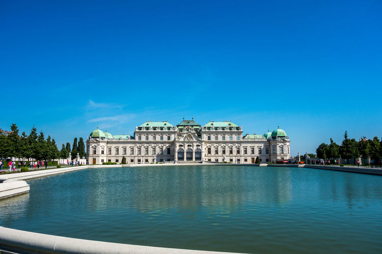 View with upper Belvedere palace Architecture Built Structure Sky Water Building Exterior Travel Destinations Blue Travel Nature Waterfront Tourism City Copy Space Clear Sky Day History The Past Building No People Outdoors Government Reflection Jason_AT EyeEm Travel Photography Travel Photography Travel Tourist Destination Tourist Belvedere Castle Belvedere Palace Belvedere Palace Upper Belvedere Schloss Belvedere