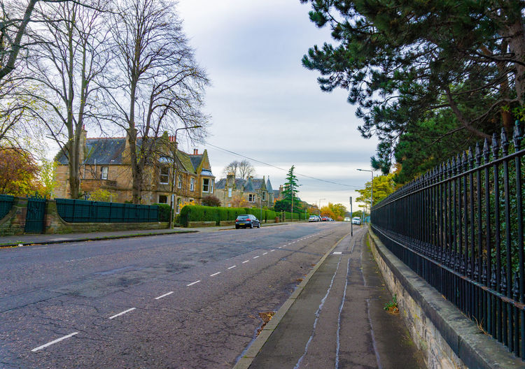 Side road view with trees and European style house LINE Tree Garden Outdoor Plant Leave Clouds Car Way Road Scotland Edinburgh Europe Autumn Background Beautiful Building City Day Edit Environment Green House Landscape Nature Old Park Season  Sky Spring Street Summer Tourism Transport Transportation Travel Trees Uk Urban View