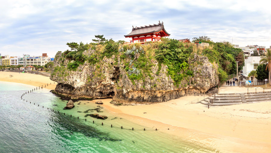 Panoramic view of japanese shinto shrine and beach against summer sky