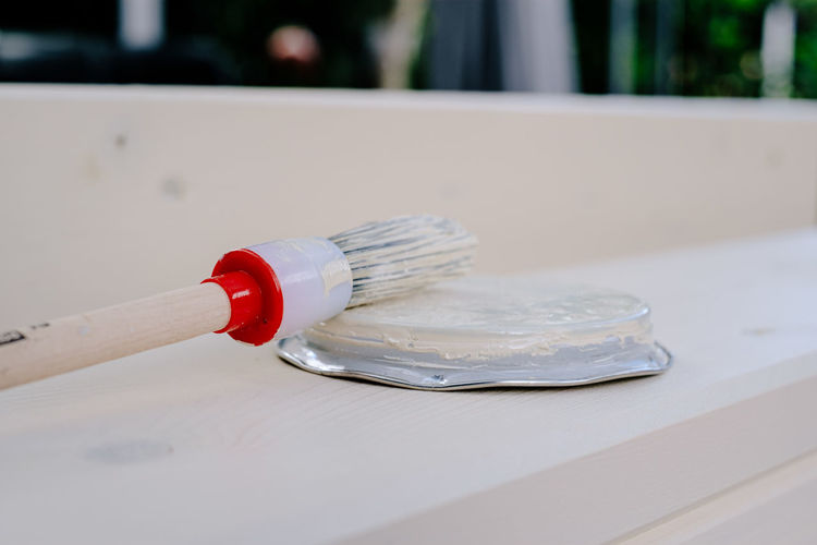 Close-up of paintbrush on table